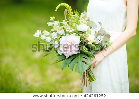 Foto stock: Legs Of The Bride And Bridesmaids And Flower Bouquets On The Bed Wedding