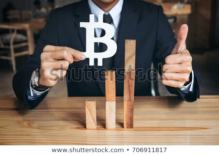 financial growth concept businessman holding showing bitcoin sy stock photo © freedomz