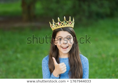 Happy motivated little girl giving a thumbs up Stock photo © Giulio_Fornasar