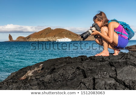 Galapagos tourist walking on Santiago Island in Galapagos Islands Stock photo © Maridav
