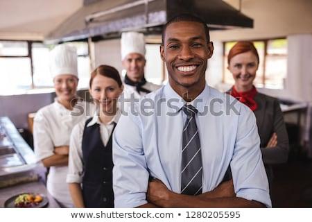 Csoport hotel áll keresztbe tett kar konyha férfi Stock fotó © wavebreak_media