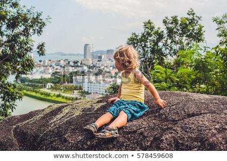 Boy tourist in the background Beautiful view on Nha Trang and Bay of the South China Sea blue sky ba Stock photo © galitskaya