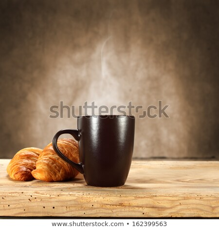 Croissant and Cup of Hot Coffee Beverage in Mug Stock photo © robuart
