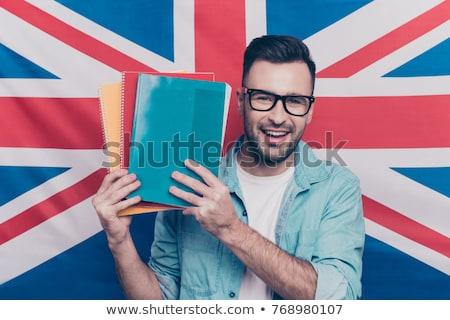 smiling young man over british flag background Stock photo © dolgachov