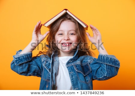 Cute little girl in smart casualwear and eyeglasses expressing amazement Stock photo © pressmaster