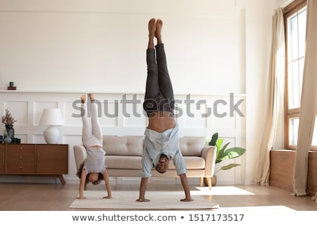 happy little african american girl with arms apart Stock photo © dolgachov