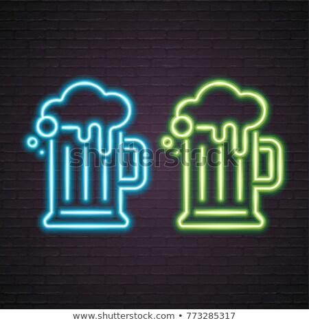 Yeşil bira kupa neon bar tanıtım Stok fotoğraf © Anna_leni