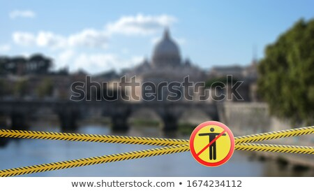 Stock photo: Crossing fencing lines and warning sign with crossed out man on the blurred background of Doge's Pal