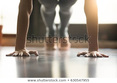 Exercise workout at home fit woman training core exercising abs with single leg plank bodyweight pla Stock photo © Maridav