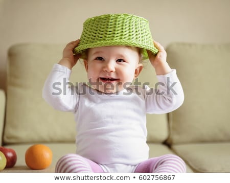 Stock photo: Naughty but Cheerful Baby Girl