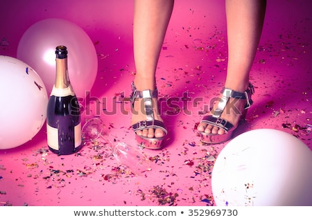 Silver party shoes on floor with champagne glass  Stock photo © Sandralise