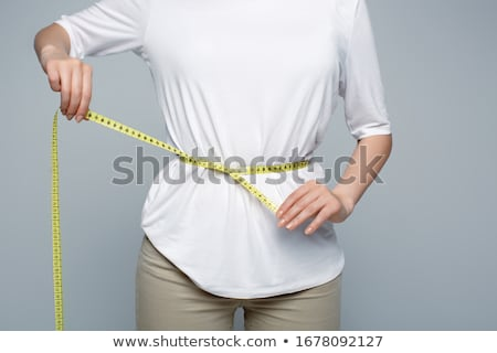 woman measures her body Stock photo © ssuaphoto