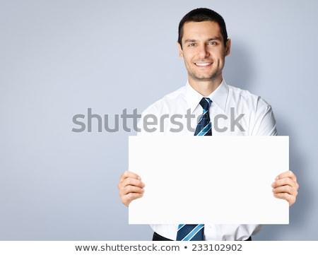 junger · Mann · halten · Karte · Porträt · weiß - stock foto © hasloo