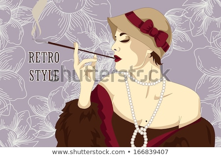 1674444 stock photo woman with cigarette holder