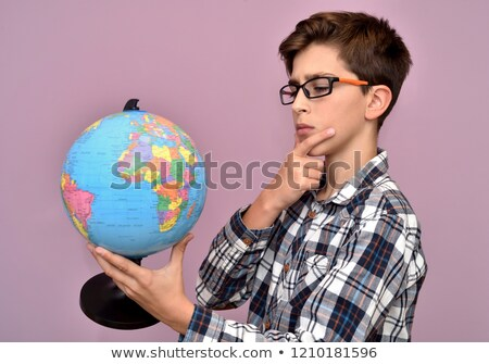 schoolboy interested in geography Stock photo © photography33