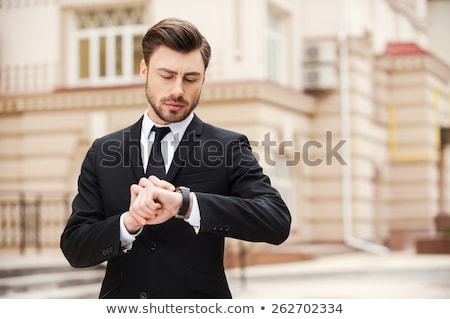 A businessman checking his watch. Stock photo © photography33