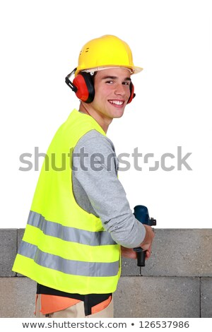 Man drilling into breeze blocks Stock photo © photography33