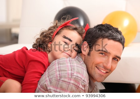 little girl on daddy's back celebrating Halloween Stock photo © photography33
