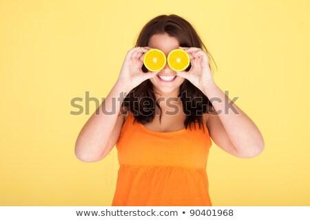 Vrouw oog orange slice voedsel haren vruchten Stockfoto © photography33