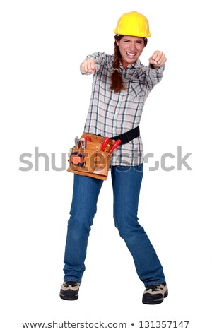 Tradeswoman gripping an invisible object and squinting Stock photo © photography33