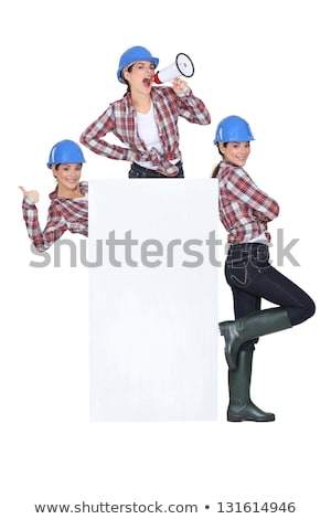 trio of girls wearing blue hard hat Stock photo © photography33