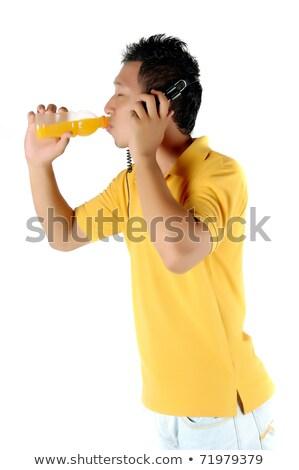 ストックフォト: 若い男 · 飲料 · ボトル · オレンジジュース · 孤立した · 白