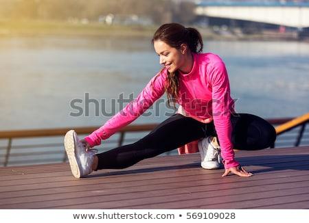 Cute flexible young woman Stock photo © acidgrey