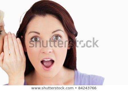 Portrait of a shocked women being told a secret in a studio stock photo © wavebreak_media
