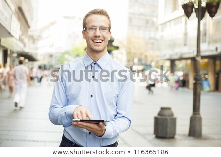 man with tablet computer in public smiling stock photo © adamr