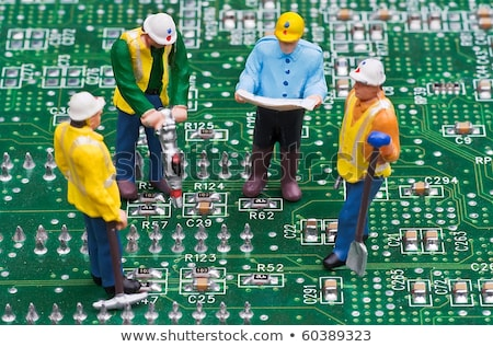 group of engineers fixing computer circuit board stock photo © kirill_m