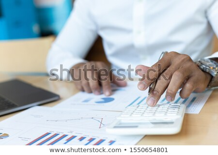 businesswomen with budget reports Stock photo © diego_cervo
