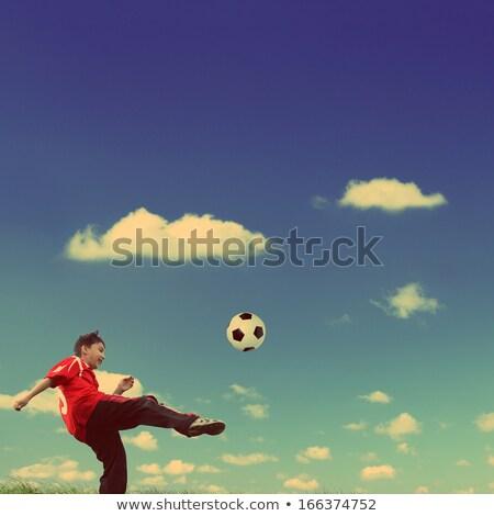 asian boy playing football   vintage retro style stock photo © mikko