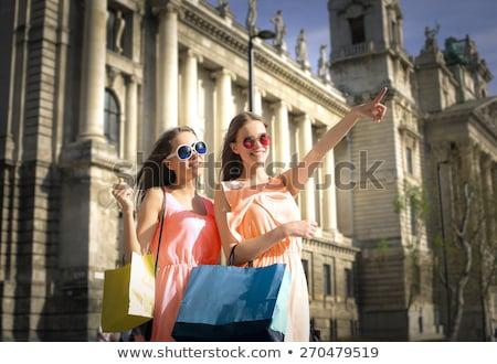 Mosolyog szőke nő színes szatyrok vásárlás turné Stock fotó © juniart