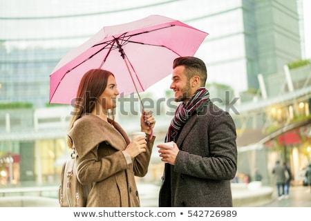 Elegant couple having a break Stock photo © konradbak