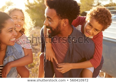 piggyback fun with family stock photo © kzenon