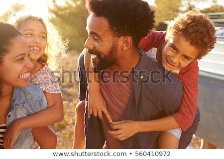 Háton jókedv család kettő gyerekek park Stock fotó © Kzenon