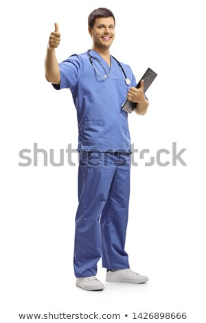 Full length young smiling male doctor showing clipboard with cop Stock photo © vlad_star
