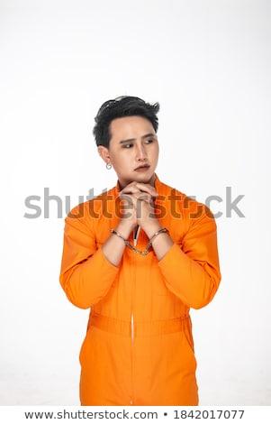 jovem · internado · cadeias · isolado · branco · homem - foto stock © elnur