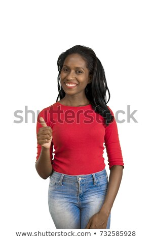 Indian young woman making thumbs up sign standing with hand on hip Stock photo © bmonteny