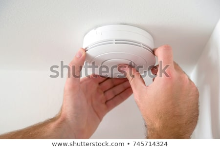Man Installing Smoke Or Carbon Monoxide Detector Stock photo © HighwayStarz