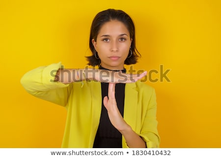 Businesswoman with pause hand gesture  Stock photo © leungchopan