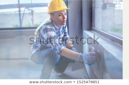 Builder with plasterboard in new building interior  Stock photo © Nejron