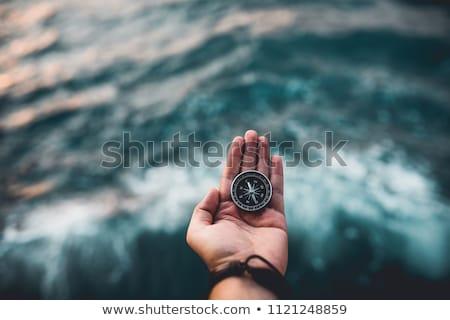 Bússola mão isolado branco homem mundo Foto stock © alexandrenunes