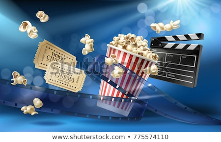 Popcorn for movie theater and cinema reel on blue background Stock photo © LoopAll