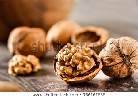 Walnut Kernels in Bowl on Rustic Wooden Background Stock photo © stevanovicigor