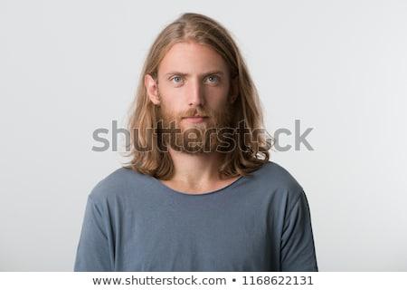 Hombre barba pelo largo mirando cámara retrato Foto stock © deandrobot