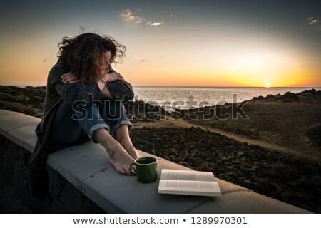 heureux · jeune · femme · séance · pierre · mer · plage - photo stock © paha_l
