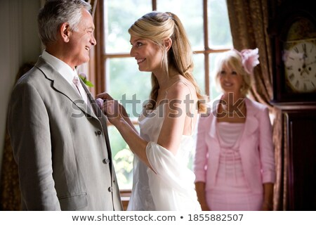 bride and mother dressing on wedding day stock photo © godfer