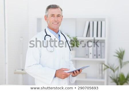 aantrekkelijk · mannelijke · arts · glimlachend · camera · naar · business - stockfoto © deandrobot
