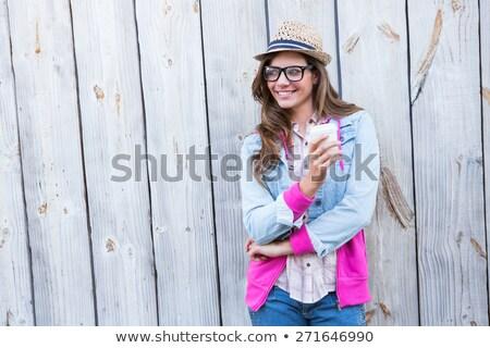 Mosolyog csinos fiatal nő tart szemüveg álmodik Stock fotó © deandrobot